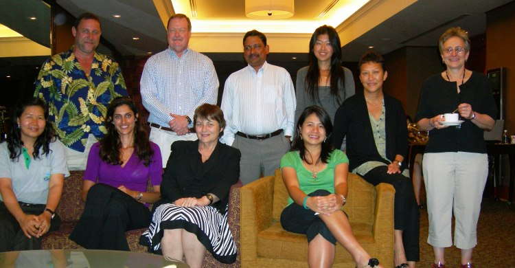 Dr. John Reynolds, standing second from the left, pictured in a group photo with expert colleagues who participated in a Strategic Dugong Survey Design Workshop in Singapore in 2010.