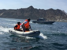 Trainees practice entanglement response on the water using boats and ropes to simulate entangled whales.