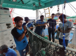 Fishers learning how to build their own TED as part of building capacity amongst the local fishing community © Marine Research Foundation