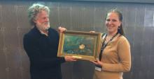 Professor Hal Whitehead, last year's ESC award winner, handing over the award to Ms. Heidrun Frisch-Nwakanma