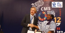 Dr. Bradnee Chambers congratulating Professor Germaine Ouedraogo Bouda on signing the Raptors MOU on behalf of Burkina Faso © Aydin Bahramlouian