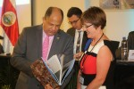 """Sharks MOS2 - President of Costa Rica, Mr Luis Guillermo Solís being presented with a copy of """"Survival: Saving Endangered Migratory Species"""" by Ms. Melanie Virtue, CMS Secretariat© IISD"""