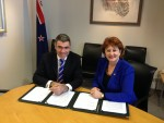 New Zealand signs the MOU - Nathan Guy (Minister for Primary Industries) and Maggie Barry (Minister of Conservation)